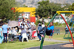 JOHANNESBURG, SOUTH AFRICA - MAY 08: A young boy plays on a swing at a Diepsloot COVID-19 screening and testing site at Diepsloot Sarafina Park on May 08, 2020 in Johannesburg, South Africa. Reports claim that in Diepsloot more than 12 000 people have been screened with over 1000 people tested. The Premier urged the people of Diepsloot to continue practicing safety measures including social distancing and wearing cloth masks when leaving home. (Photo by Dino Lloyd)
