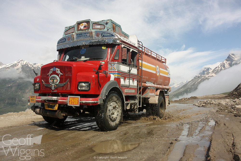 Indian Tata 1613 fuel tanker truck climbs above the Himalayan clouds as it negotiates the hazardous Rohtang Pass on the road to Pang, Ladakh, Northern India