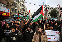 January 2, 2018 - Gaza City, The Gaza Strip, Palestine - Palestinian employees of Gaza strip hold banners and Palestine flags during a demonstration demanding their rights, in Gaza city. (Credit Image: © Hassan Jedi/Quds Net News via ZUMA Wire)