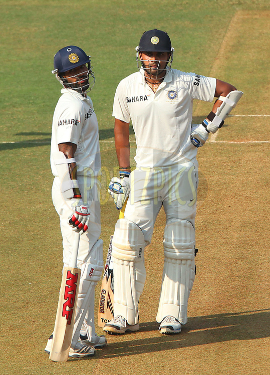 Shikhar Dhawan of India and Murali Vijay of India  during day one of the second Star Sports test match between India and The West Indies held at The Wankhede Stadium in Mumbai, India on the 14th November 2013<br /> <br /> This test match is the 200th test match for Sachin Tendulkar and his last for India.  After a career spanning more than 24yrs Sachin is retiring from cricket and this test match is his last appearance on the field of play.<br /> <br /> <br /> Photo by: Ron Gaunt - BCCI - SPORTZPICS<br /> <br /> Use of this image is subject to the terms and conditions as outlined by the BCCI. These terms can be found by following this link:<br /> <br /> http://sportzpics.photoshelter.com/gallery/BCCI-Image-Terms/G0000ahUVIIEBQ84/C0000whs75.ajndY