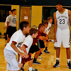 Aug 1, 2013; Metairie, LA, USA; New Orleans Pelicans forward Anthony Davis (23) during a Pelicans junior camp following a uniform unveiling at the team practice facility. Mandatory Credit: Derick E. Hingle-USA TODAY Sports