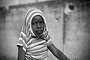 Seven year old Malian girl Ageisha Yattara poses for a photograph in the street in which she lives in Diabaly, Mali 26 January 2013. This photograph is part of a picture package of portraits showing children living along the same street in the small rice growing community of the northern Malian town of Diabaly who in the month of January 2013 lived through a rapid chain of events in the Malian war.