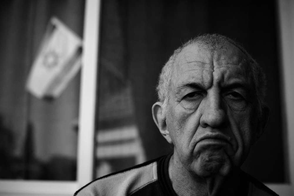 Holocaust survivor Michael Antushewicz, 70, sits on a bench in the yard of the Shaar Menashe Mental Health Center for Holocaust survivors in Pardes Hanna, Israel on Nov 2, 2010. Antushewicz was born in Belarus and emigrated to Israel in 1966.