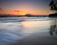 Wave motion on beach at sunset, Maui, Hawaii