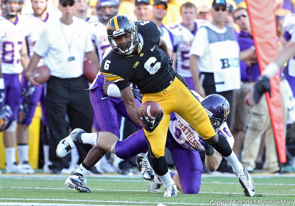 September 15 2012: Iowa Hawkeyes wide receiver Keenan Davis (6) spins away from Northern Iowa Panthers linebacker Jake Farley (46) after a catch during the second half of the NCAA football game between the Northern Iowa Panthers and the Iowa Hawkeyes at Kinnick Stadium in Iowa City, Iowa on Saturday September 15, 2012. Iowa defeated Northern Iowa 27-16.