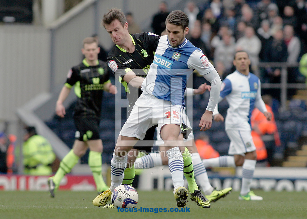 Picture by Michael Sedgwick/Focus Images Ltd +44 7900 363072.23/02/2013.David Bentley of Blackburn Rovers and Michael Tonge of Leeds United in action during the npower Championship match at Ewood Park, Blackburn.