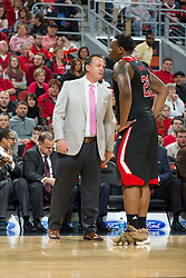 North Carolina State head coach Mark Gottfried, left, talks with forward Beejay Anya. <br /> <br /> The University of Louisville hosted the North Carolina State, Saturday, Feb. 14, 2015 at the Yum Center in Louisville. <br /> <br /> Photo by Jonathan Palmer