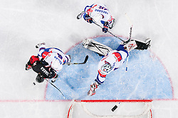 Go Tanaka of Japan vs Mitja Robar  of Slovenia and Andrej Hocevar of Slovenia during ice-hockey match between Slovenia and Japan at IIHF World Championship DIV. I Group A Slovenia 2012, on April 16, 2012 in Arena Stozice, Ljubljana, Slovenia. Slovenia defeated Japan 4-2. (Photo by Vid Ponikvar / Sportida.com)