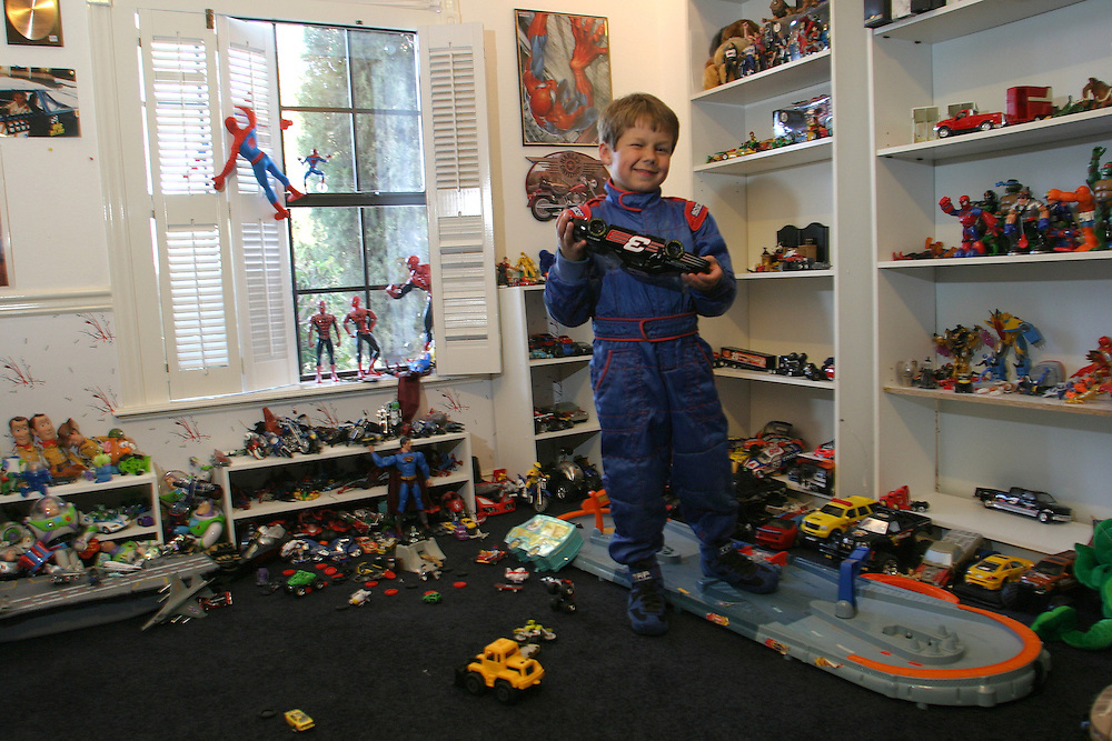 Chris Trickle 6 playing with his cars toys in his room at Las Vegas Nevada. Thursday March 1.2007....Chris  is a professional go kart race driver...He weans few competitions in Nevada and California...He rise up in a family that in the NASCAR drivers his grandfather was a NASCAR driver and his ankle is a champion of NASCAR drivers...His dream is to drive a NASCAR car that belongs to his uncle that he name after and got killed in Las Vegas. ..