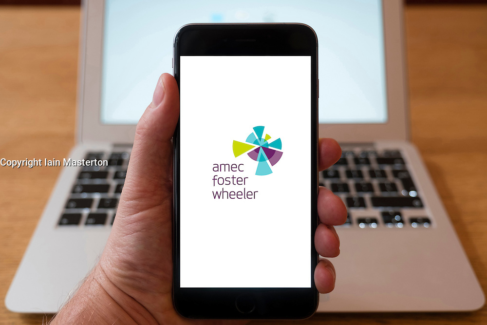 Using iPhone smartphone to display logo of Amec Foster Wheeler construction and engineering group