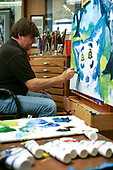 George Rodrigue painting in his studio