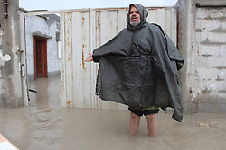 A man stands in front of his flooded house in the southern Gaza Strip city of Rafah, Jan. 9, 2013. Rescuers have been sent to evacuate dozens of from their flooded houses since heavy rain and snow hit the region on Monday, January 9, 2013. Photo by Imago / i-Images...UK ONLY