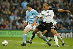 MANCHESTER, ENGLAND - Saturday, March 27, 2004: Manchester City's Jon Mackin is checked by Fulham's Alain Goma in the area but no penalty was given during the Premiership match at the City of Manchester Stadium. (Pic by David Rawcliffe/Propaganda)