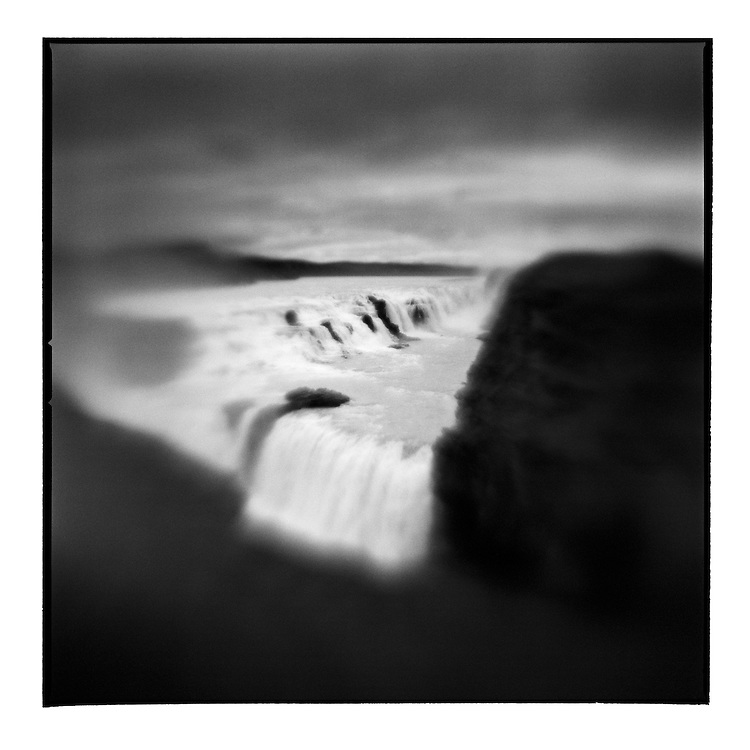 Iceland, Blurred black and white image of Hvita River roaring 32 meters over Gullfoss waterfall on summer evening