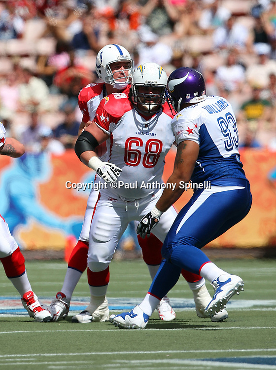 HONOLULU, HI - FEBRUARY 08: AFC All-Stars Kris Dielman #68 of the San Diego Chargers blocks defensive tackle Pat Williams #94 of the Minnesota Vikings of the NFC All-Stars in the 2009 NFL Pro Bowl at Aloha Stadium on February 8, 2009 in Honolulu, Hawaii. The NFC defeated the AFC 30-21. ©Paul Anthony Spinelli *** Local Caption *** Kris Dielman