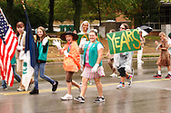 Girl Scouts, celebrating 100 years, march in the 2012 Holiday at Home Parade on Far Hills Avenue in Kettering, Monday, September 3, 2012.