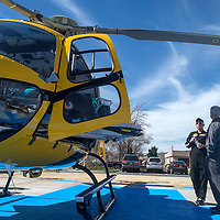 Virginia Williams, pilot for the medical helicopter, speaks with Cibola General CEO Thomas Whelan during the unveiling of the new helicopter in Grants Friday.