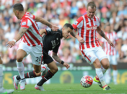 Philippe Coutinho of Liverpool attempts to pass Geoff Cameron of Stoke City - Mandatory byline: Dougie Allward/JMP - 07966386802 - 09/08/2015 - FOOTBALL - Britannia Stadium -Stoke-On-Trent,England - Stoke City v Liverpool - Barclays Premier League