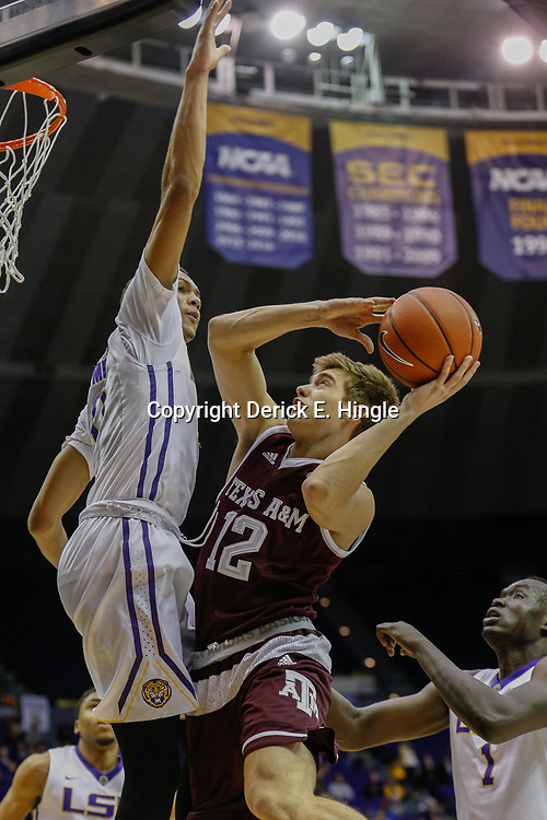 Feb 4, 2017; Baton Rouge, LA, USA; Texas A&M Aggies guard Chris Collins (12) shoots as LSU Tigers guard Brandon Sampson (0) defends during the first half at the Pete Maravich Assembly Center. Mandatory Credit: Derick E. Hingle-USA TODAY Sports