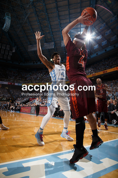 CHAPEL HILL, NC - JANUARY 26: Isaiah Hicks #4 of the North Carolina Tar Heels defends Seth Allen #4 of the Virginia Tech Hokies on January 26, 2017 at the Dean Smith Center in Chapel Hill, North Carolina. North Carolina won 91-72. (Photo by Peyton Williams/UNC/Getty Images) *** Local Caption *** Isaiah Hicks;Seth Allen