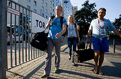 Athletes Matic Osovnikar  and Pia Tajnikar of Slovenia  helping with Khalid Nasif at departure back to Slovenia during day five of the 12th IAAF World Athletics Championships at the Hotel Estrel on August 18, 2009 in Berlin, Germany. (Photo by Vid Ponikvar / Sportida)