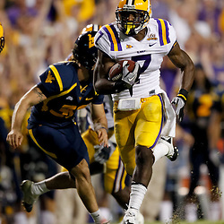 Sep 25, 2010; Baton Rouge, LA, USA; LSU Tigers cornerback Patrick Peterson (7) returns a punt for a touchdown against the West Virginia Mountaineers during the first half at Tiger Stadium.  Mandatory Credit: Derick E. Hingle