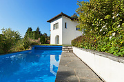 White house in classic style with swimming pool