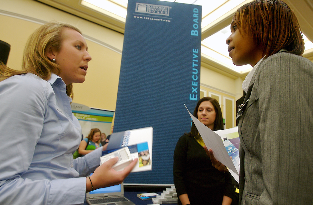 Ohio University freshman Ashley Jones, right, speaks with Corporate Executive Boards recruiter Betsey Roe about internships during the career fair in the Baker University Center on Wednesday, October 3, 2007..photo by Kevin Riddell