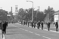 Police line the streets nearby Rossington Colliery in Doncaster, South Yorkshire during the Miners Strike. 2 October 1984