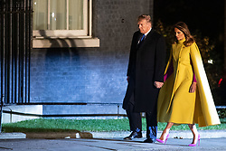 © Licensed to London News Pictures. 03/12/2019. London, UK. President of the USA Donald Trump and First Lady Melania Trump arrive at 10 Downing Street for a reception hosted by UK Prime Minister Boris Johnson. International leaders are visiting the UK for to mark the 70th anniversary of the North Atlantic Treaty Organisation (NATO) Photo credit : Tom Nicholson/LNP
