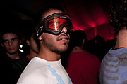 MALE CLUBBER WITH BEARD AND SKI GOGGLES