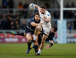 Exeter Chiefs' Alex Cuthbert (centre) avoids a tackle from Sale Sharks Rob Webber (right) and Rohan Janse van Rensburg during the Gallagher Premiership match at the AJ Bell Stadium, Salford.