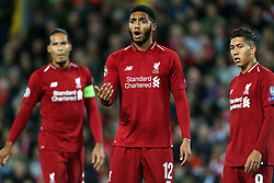 Liverpool's Joe Gomez (centre) and Liverpool's Roberto Firmino