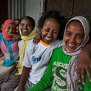 Young women at Biruh Tesfa, in Addis Ababa. Biruh Tesfa means bright future in Amharic, and is a program for urban adolescent girls at risk of exploitation and abuse. For many girls, going to Biruh Tesfa is their only hope of an education and a respite from their domestic work. ..The program promotes functional literacy, life skills, livelihoods skills, and HIV/reporductive health education through girls' clubs led by adult female mentors. The girls' clubs are held in meeting spaces donated by the kebele (local administration).