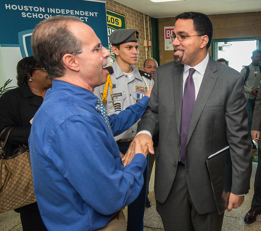 Robert Gasparello, left, greets Acting US Secretary of Education John King, right, for a visit to Sharpstown High School, January 15, 2016.