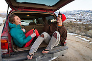 Hannah Hall and Kevander Baldwin enjoy a beer after a day of bouldering.<br /> The Buttermilks, California