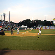 Tony Thomas, (left), New Britain Rock Cats, prepares to bat as Aaron Hicks walks during the New Britain Rock Cats Vs Binghamton Mets Minor League Baseball game at New Britain Stadium, New Britain, Connecticut, USA. 2nd July 2014. Photo Tim Clayton
