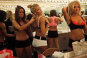 Baltimore Ravens cheerleader hopefuls prepare prior to performing during tryouts for the Ravens cheerleaders in Baltimore, Maryland, March 6, 2011.