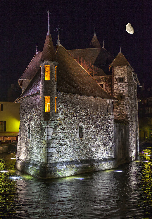 Palais de l'Isle. The 12th century old prison at night on the Thiou Canal in Annecy, France. Moonlight, March, 2013.