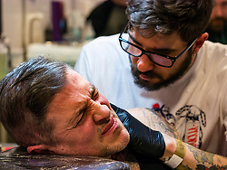 Pictured: Scottish Tattoo Convention. 30 March 2019  Pictured: Enthusiasts and 200 artists gather at the 9th Annual convention where many take the opportunity to have a new tattoo. <br /> Sally Anderson   EdinburghElitemedia.co.uk