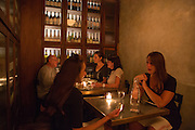 New York, NY, Sept. 10....shots of the restaurant Estela. Diners in a small dining nook. The nook opens to the dinign room.