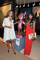 Left to right, RANDA KAYAT and JACKIE ST.CLAIR at a preview evening of the annual London LAPADA (The Association of Art & Antiques Dealers) antiques Fair held in Berkeley Square, London on 20th September 2011.