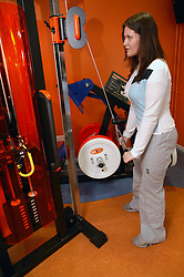 Young woman using weights at an inclusive fitness gym,