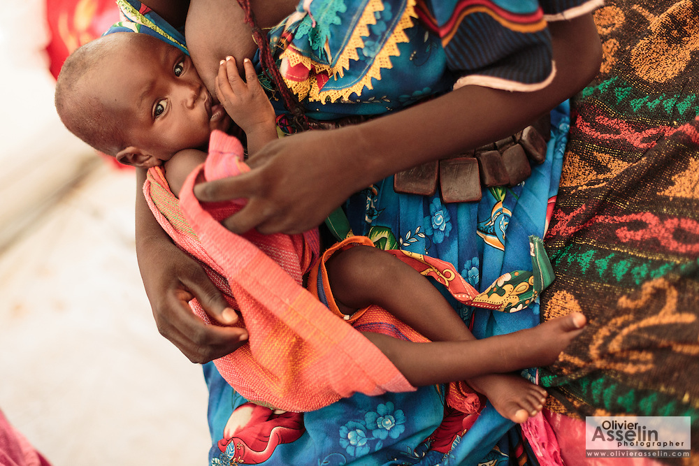 Achta Hussain (doesn't know her age), breastfeeds her son Hassan Hussain, 5 mo., who is recovering from malnutrition at a UNICEF-sponsored therapeutic feeding center at the Mongo hospital in the town of Mongo, Guera province, Chad on Tuesday October 16, 2012.