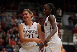 Dec 20, 2011; Stanford CA, USA;  Stanford Cardinal guard Toni Kokenis (31) is congratulated by forward Chiney Ogwumike (13) during the second half against the Tennessee Lady Volunteers at Maples Pavilion.  Stanford defeated Tennessee 97-80. Mandatory Credit: Jason O. Watson-US PRESSWIRE