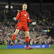 Eric Kronberg celebrates Sporting KC's goal during the first half at Sporting Park.