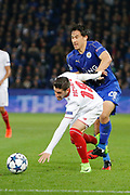 Sevilla defender Sergio Escudero (18) battles for possession with Leicester City Forward Shinji Okazaki during the Champions League round of 16, game 2 match between Leicester City and Sevilla at the King Power Stadium, Leicester, England on 14 March 2017. Photo by Richard Holmes.