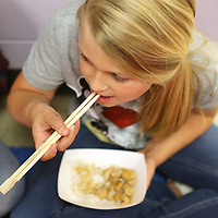 Saltillo Elementary School fourth grader Kellum Austin uses chopsticks to eat hibachi chicken and rice during their Japanese culture day at the culmination of their unit on the country and it's culture.