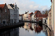 BRUGES, BELGIUM - FEBRUARY 06 : A general view of a canal on February 06, 2009 in Bruges, West Flanders, Belgium. The bright colors of the residential houses along the canal are reflected in the cool water. (Photo by Manuel Cohen)