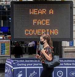 © Licensed to London News Pictures. 14/08/2020. London, UK. A large police presence at Victoria Station this morning as Prime Minister Boris Johnson announces that fines for not wearing a face mask on public transport and shops will rise to £3,200. Photo credit: Alex Lentati/LNP